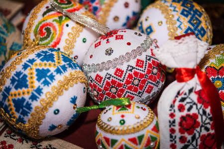 Balls with an embroidered floral pattern to decorate the Christmas tree