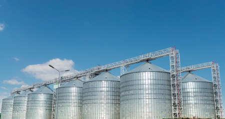 elevator cisterns (storage for grain) and garage for trucks 版權商用圖片