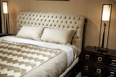 luxury double bed leather back with pillows powder colorin the bedroom