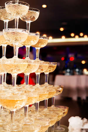 champagne glasses standing in a tower at the party
