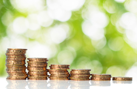 Coins with green bokeh background