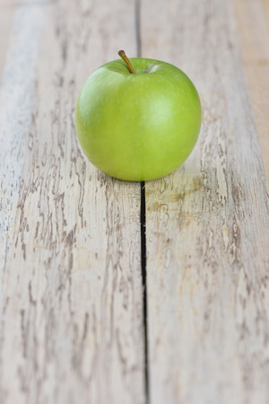 Sweet green apple on wooden background Stock Photo