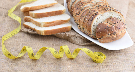 sliced bread: sliced bread and measure tape on gunny