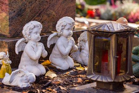 Praying angel statues at a german graveyard site