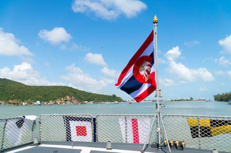 Thai flag with beautiful blue sky and lake view