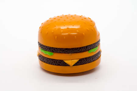 Small toy burger isolated on white background.
