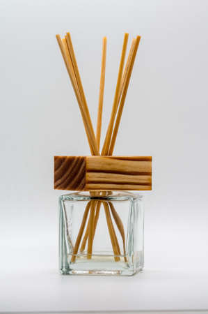 Clear glass bottle with wooden cover and bamboo stick. Standard-Bild