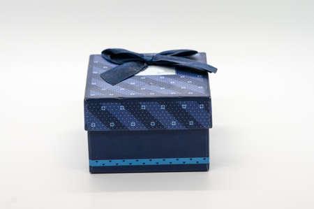 Blue gift box isolated on white background.