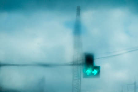 trafic: Photo of water drop on car front glass with blurry view of trafic light. Stock Photo