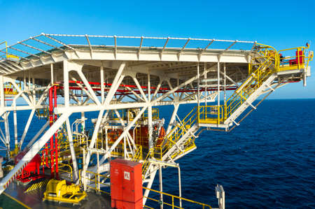 Helicopter landing deck on offshore jack up drilling rig with beautiful sae view.