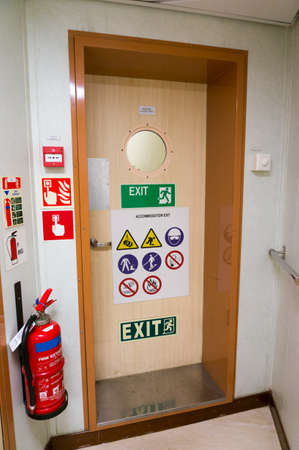 Emergency exit on offshore jack up drilling rig with fire extinquisher in case of fire. Stock Photo