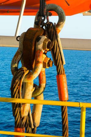Big jackle and sling hanging on offshore jackup drilling rig.