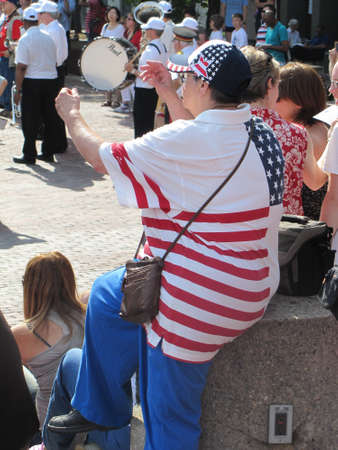 navigational light: a woman wearing a shirt with USA flag at the 4th of July , Boston, 2011