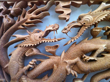 Wooden carve of two fighting dragons