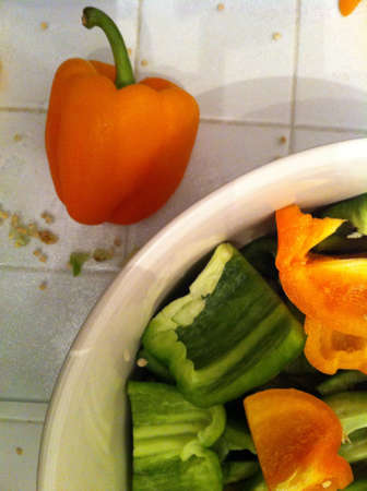 Orange pepper with cut peppers