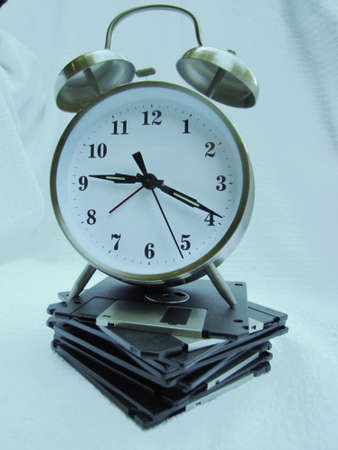 career timing: old fashion clock on floppies  Stock Photo