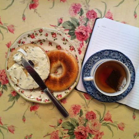 cloth: Bagel with cream cheese and tea breakfast