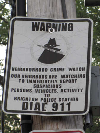burgler: Neighborhood Watch warning sign Editorial