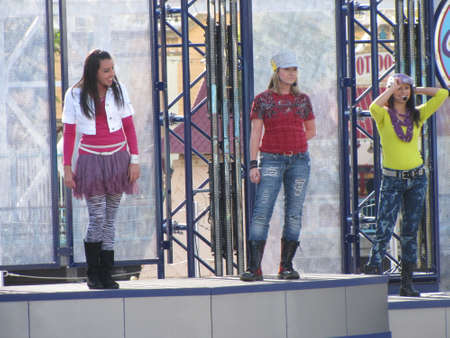 dance time: three girls preform dance show in Disneyland at CA, USA, Christmas time 2010