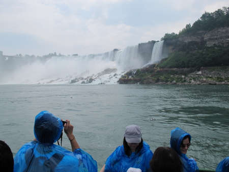 american falls: American Falls at Niagara on the US  Canadian border. On the water a touristic boat June 2010