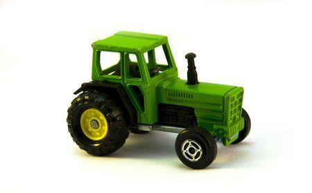 motor de carro: Un juguete verde tractor  Foto de archivo