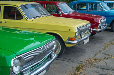 Vintage vehicles are in the parking lot on the city show.
