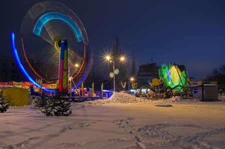 Snapshot amusement park at night during winter