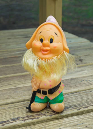 Old rubber toy in form of a bearded gnome for young children Stock Photo