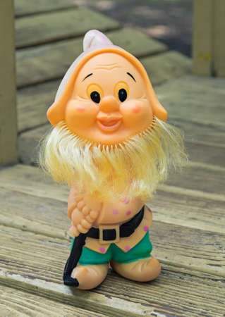 springy: Old rubber toy in form of a bearded gnome for young children Stock Photo