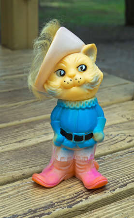 springy: Old rubber toy in form of a Puss in Boots for young children Stock Photo