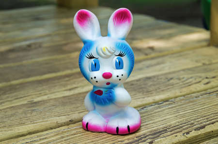 Old rubber toy in form of a colored rabbit for young children Stock Photo