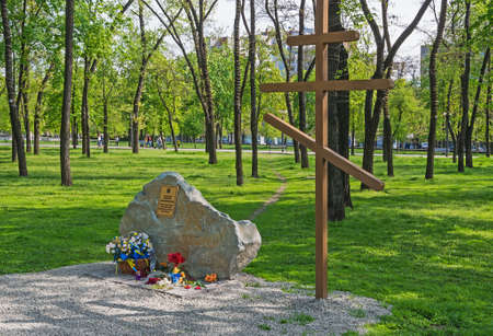 Dnepropetrovsk, Ukraine - April 24, 2014: Cross and memorial stone in honor of the lost Celestial Hundreds during Euromaidan