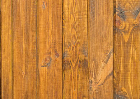 Pine boards treated with creosote to protect against external influences and wood beetle pests