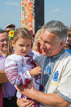 Dnepropetrovsk, Ukraine - September 13, 2014: Dnepropetrovsk Mayor Ivan Kulichenko holds a child by demonstrating closeness to the people