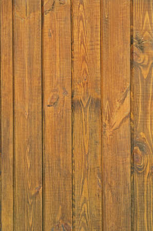 Pine boards treated with wood stain to protect against external influences and wood beetle pests 写真素材