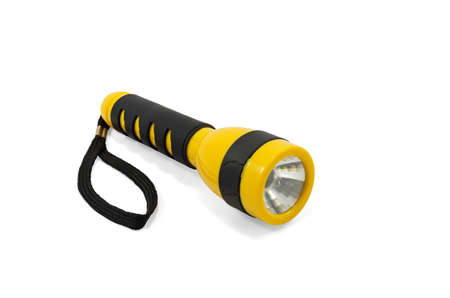 Yellow and black pocket electric flashlight isolated on white background