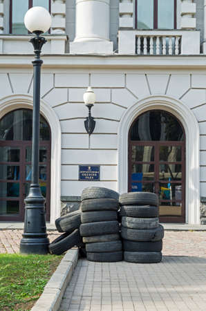 Dnepropetrovsk, Ukraine - October 05, 2015: Car tires in front of the main entrance in the Dnipropetrovsk regional administration in protest