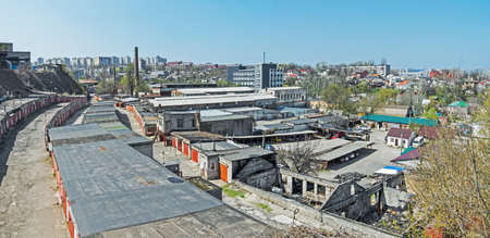 View of the city, where old intermingles industrial zone, residential buildings and ruins Editorial