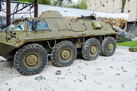 Dnepropetrovsk, Ukraine - May 19, 2016: Open air museum dedicated to war in the Donbass. Survivor armored troop-carrier of the Donetsk airport