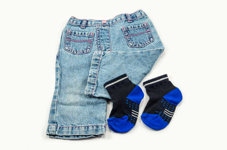 Denim pants and socks for children aged 1-2 years isolated on a white background