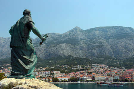 saint peter: Saint Peter statue and the view of Makarska town. Stock Photo
