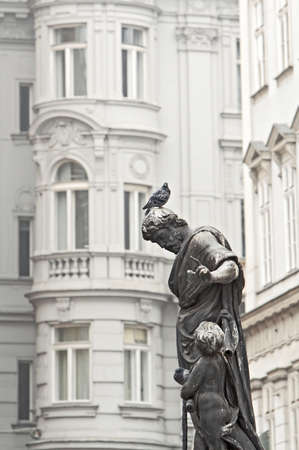 The sculpture with pigeons in Vienna street, Austria Stock Photo - 15715248
