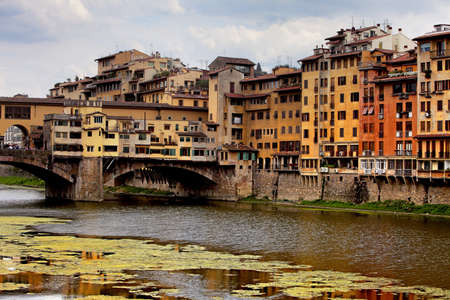 sightseeng: Ponte Vecchio, a medieval bridge over the Arno River in the evening Stock Photo
