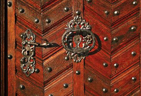 Detail of the door in the sunlight Stock Photo - 17179117