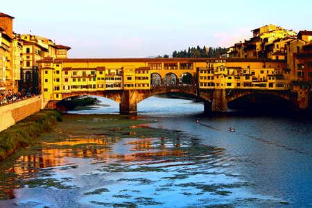 vechio:  Ponte Vecchio, a medieval bridge over the Arno River in the evening