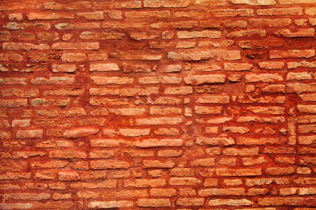 sienna: The weather worn red brick wall texture