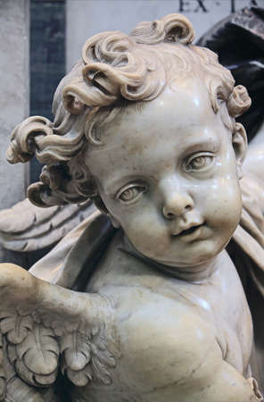 Cupid from holy water font in St  Peter's Basilica, Rome photo
