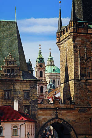 st nicholas cathedral:  Lesser Town of Prague with the bridge tower in the foreground and st  Nicholas church in the background Stock Photo