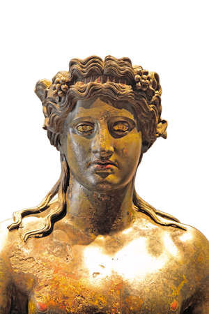 The detail of bronze statue of Dionysus with grape vines in long hair photo