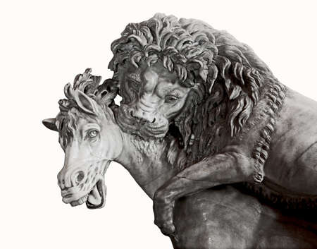 Isolated detail of ancient sculpture depicting lion attacking a horse Stock Photo